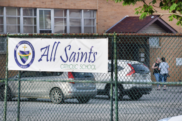 Photo by Scott McCloskey Parents exit All Saints Catholic School in Moundsville Thursday after a meeting, following which the Roman Catholic Diocese of Wheeling-Charleston announced it is closing the school.