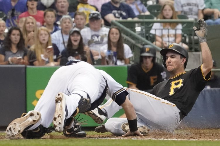Milwaukee Brewers catcher Jett Bandy tags out Pittsburgh Pirates' Adam Frazier at home during the eighth inning of a baseball game Thursday, June 22, 2017, in Milwaukee. (AP Photo/Morry Gash)