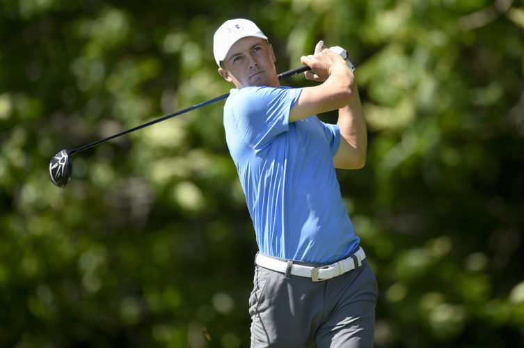 Jordan Spieth watches his tee shot on the 12th hole during the first round of the Travelers Championship golf tournament Thursday, June 22, 2017, in Cromwell, Conn. (John Woike/Hartford Courant via AP)
