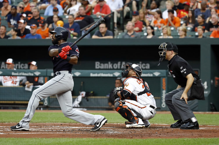 Cleveland Indians' Austin Jackson follows through on a triple in front of Baltimore Orioles catcher Welington Castillo and home plate umpire Adam Hamari during the second inning of a baseball game in Baltimore, Thursday, June 22, 2017. (AP Photo/Patrick Semansky)