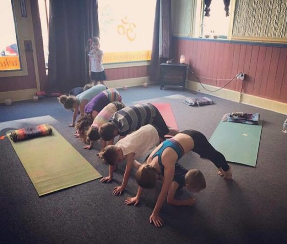 Photo Provided Children participate in a yoga class at Happy Goat Yoga in North Wheeling. Instructor Nikki Kiger will wrap up the first summer session of kids' yoga classes Tuesday and a second four-week session will begin on July 18.