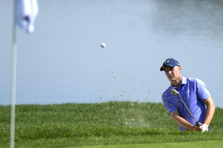 Jordan Spieth blasts out of a bunker on the 16th hole during the second round of the Travelers Championship golf tournament at TPC River Highlands on Friday, June 23, 2017, in Cromwell, Conn. (Patrick Raycraft/Hartford Courant via AP)