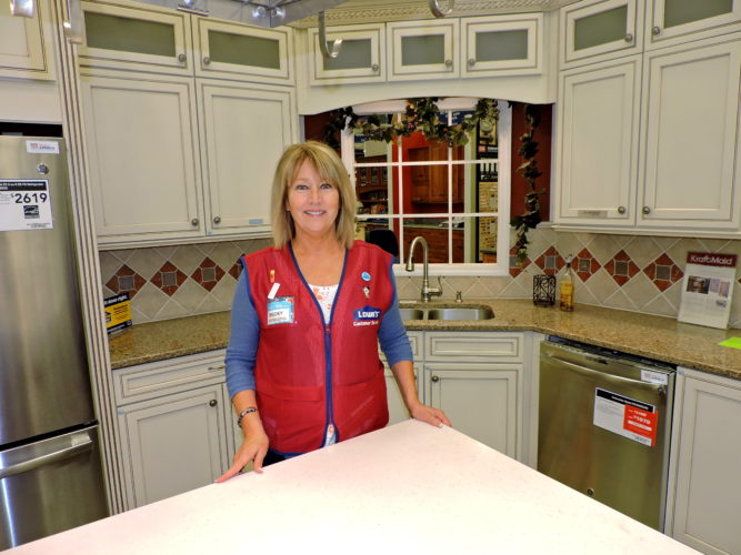 Photo by Shelley Hanson Becky Kessler, a kitchen designer at the Lowe's in Wheeling, stands in one of the model kitchen at the store.