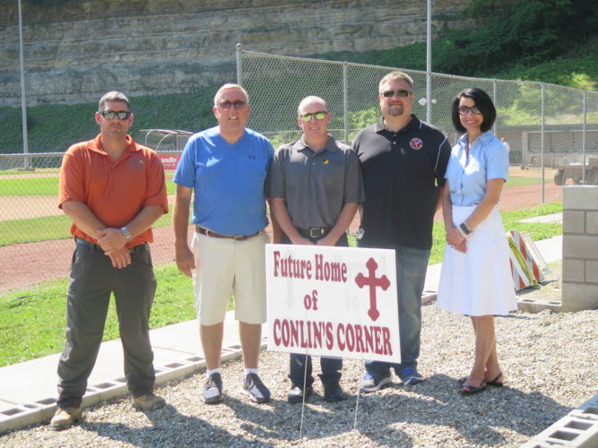 Photos by Joselyn King Those involved with the construction of Conlin's Corner at the J.B. Chambers I-470 baseball fields in Wheeling gather to celebrate its near-completion. Pictured from left are Eran Molz, business agent for International Union of Operating Engineers Local 132; Tom Bechtel, recreation director for the city of Wheeling; Doug Costain, project coordinator and volunteer; Frank Eberhart III, business agent for Bricklayers & Allied Craftworkers District Council of West Virginia Local 1 in Wheeling and 11 in Weirton; and Ginny Favede, executive director of the Ohio Valley Construction Employers Council.