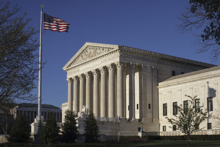 In this photo taken on Tuesday, April 4, 2017, the Supreme Court Building is seen in Washington. The Supreme Court is expected to decide in the next few days whether the Trump administration can enforce a ban on visitors to the United States from six mostly Muslim countries. The legal fight has been going on since President Donald Trump rolled out a ban a week after his inauguration.  (AP Photo/J. Scott Applewhite)