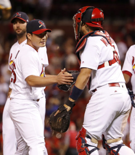 St. Louis Cardinals relief pitcher Seung-Hwan Oh, left, and catcher Yadier Molina celebrate following a 8-4 victory over the Pittsburgh Pirates in a baseball game Sunday, June 25, 2017, in St. Louis. (AP Photo/Jeff Roberson)