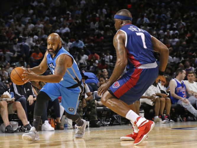 Power Moochie Norris, left, drives as Tri-State player/captain Jermaine O'Neal (7) defends during the first half of the Game 2 in the BIG3 Basketball League debut, Sunday, June 25, 2017, at the Barclays Center in New York. (AP Photo/Kathy Willens)