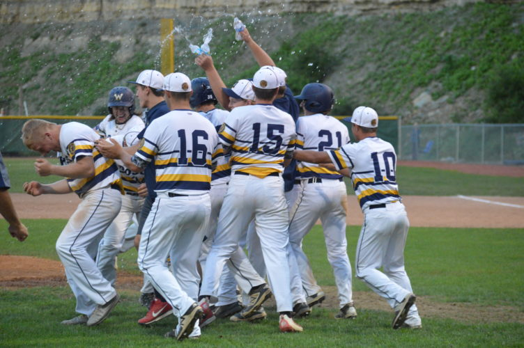 Photo by Cody Tomer Wheeling players celebrate after Gage Giovengo, left, supplied a walk-off sacrifice fly to win Monday's American Legion baseball game.