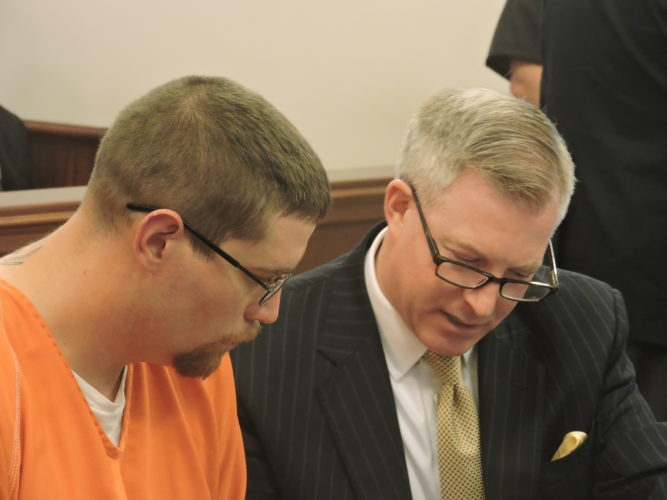 Photo by Robert A. DeFrank David Carl Kinney, left, accused of fatally shooting Brad McGarry in Bellaire, consults with his defense attorney, Chris Gagin in court Tuesday. Kinney's request for a reduction of his $1 million bond was denied.