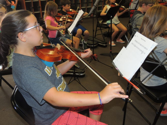 Photo by Drew Parker Marshall County Strings student Elizabeth Howard practices Tuesday during the program's annual summer camp.
