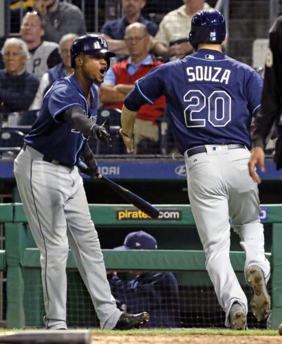 Tampa Bay Rays' Steven Souza Jr. (20) is greeted by Tim Beckham after scoring from first on an error by Piratess third baseman David Freese on a ball hit by Wilson Ramos during the 10th inning of a baseball game in Pittsburgh, Tuesday, June 27, 2017. The Rays won 4-2. (AP Photo/Gene J. Puskar)