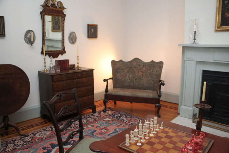The Game Room at the Mansion Museum includes a Chippendale-style sofa with claw feet and wool embroidered upholstery.