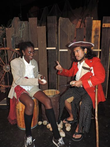 "Photo Provided Eldana Smith plays Jim Hawkins and Juan Dunlap plays Long John Silver in the Parcel Players' production of ""Treasure Island,"" which will be staged July 12-15 at Oglebay Institute's Towngate Theatre."