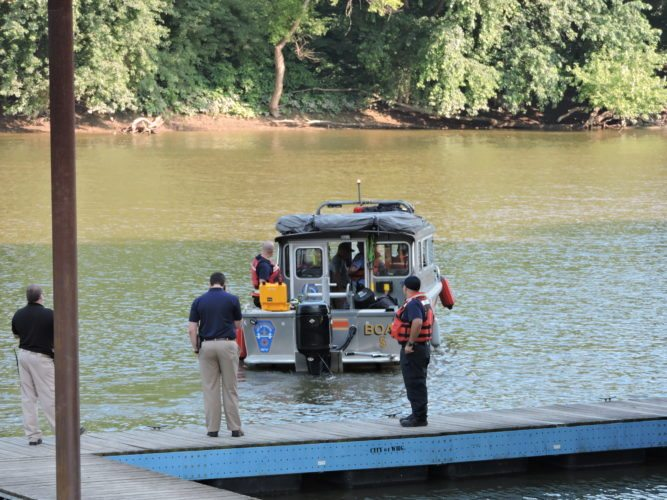Photo by Heather Ziegler Wheeling Area Underwater Special Tactics Team crews search the back channel of the Ohio River for boater Jerry Dowd Jr. on Wednesday. A body believed to be Dowd was found in the river Thursday afternoon.