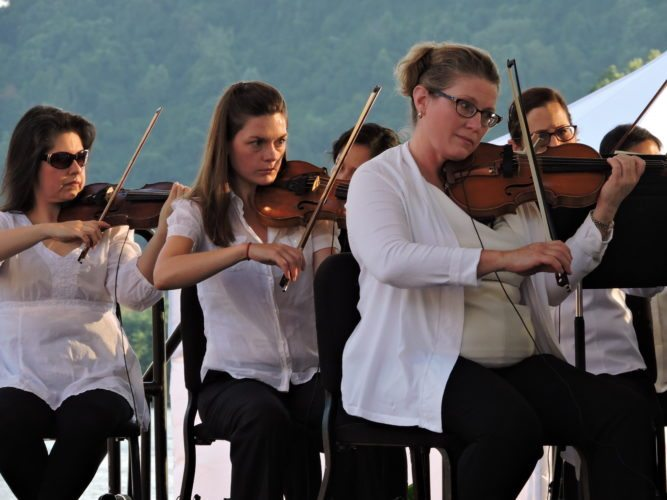 Photo by Casey Junkins Members of the Wheeling Symphony Orchestra perform an Independence Day show at Heritage Port.