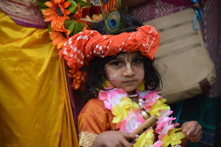 Bhumi Bhat, daughter of Sundari Devidasi of New Vrindaban, wears colorful attire during the Ratha Yatra chariot parade.