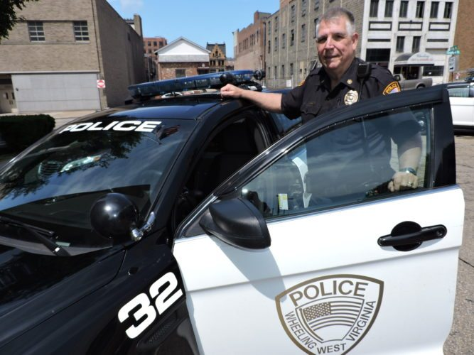 Photo by Casey Junkins Wheeling Deputy Police Chief Martin Kimball enters a cruiser. He said a lack of human resources within the department hinders its effectiveness.