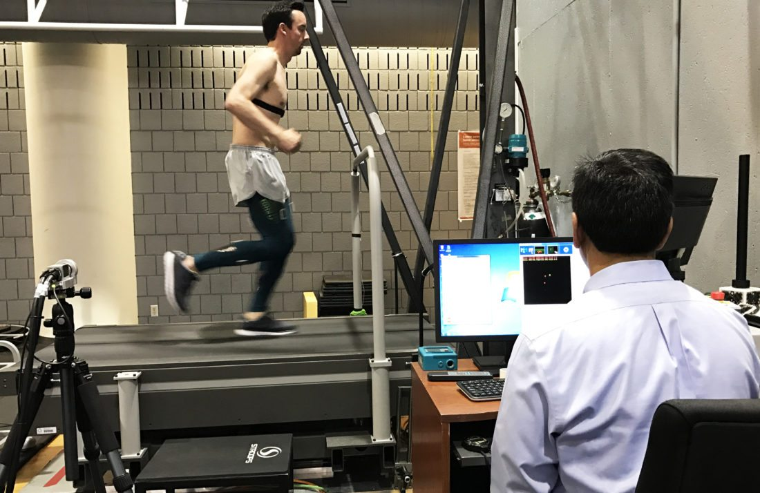 Ajit Chaudhari, an associate professor at The Ohio State Wexner Medical Center, monitors a runner using motion sensor technology to study the effects of compression tights on muscle vibration and fatigue.
