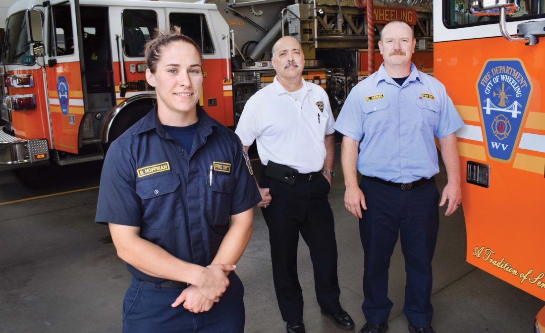 Photo by Scott McCloskey   Wheeling Firefighter/EMT Brittany Hoffman, left, is pictured at the department's headquarters in Center Wheeling along with her supervisors, Asst. Chief Paul Harto, center, and Lt. Ed Geisel Jr.