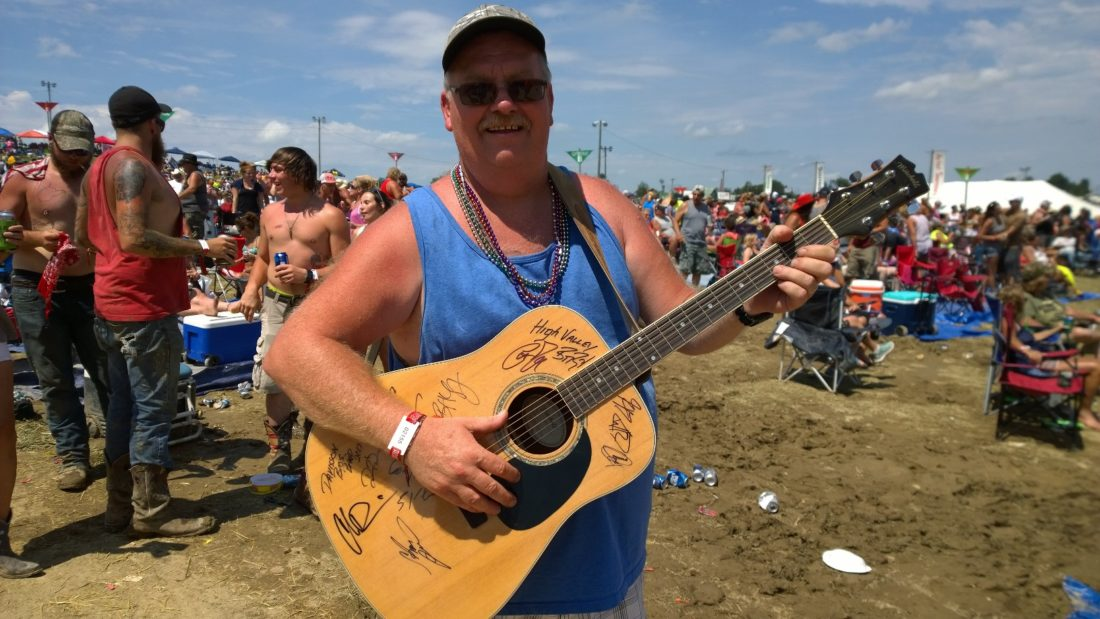 Photo by Jennifer Compston-Strough Tim Lucas of Barnesville holds his guitar a few minutes after Sammy Kershaw signed it while performing at Jamboree In The Hills on Sunday.
