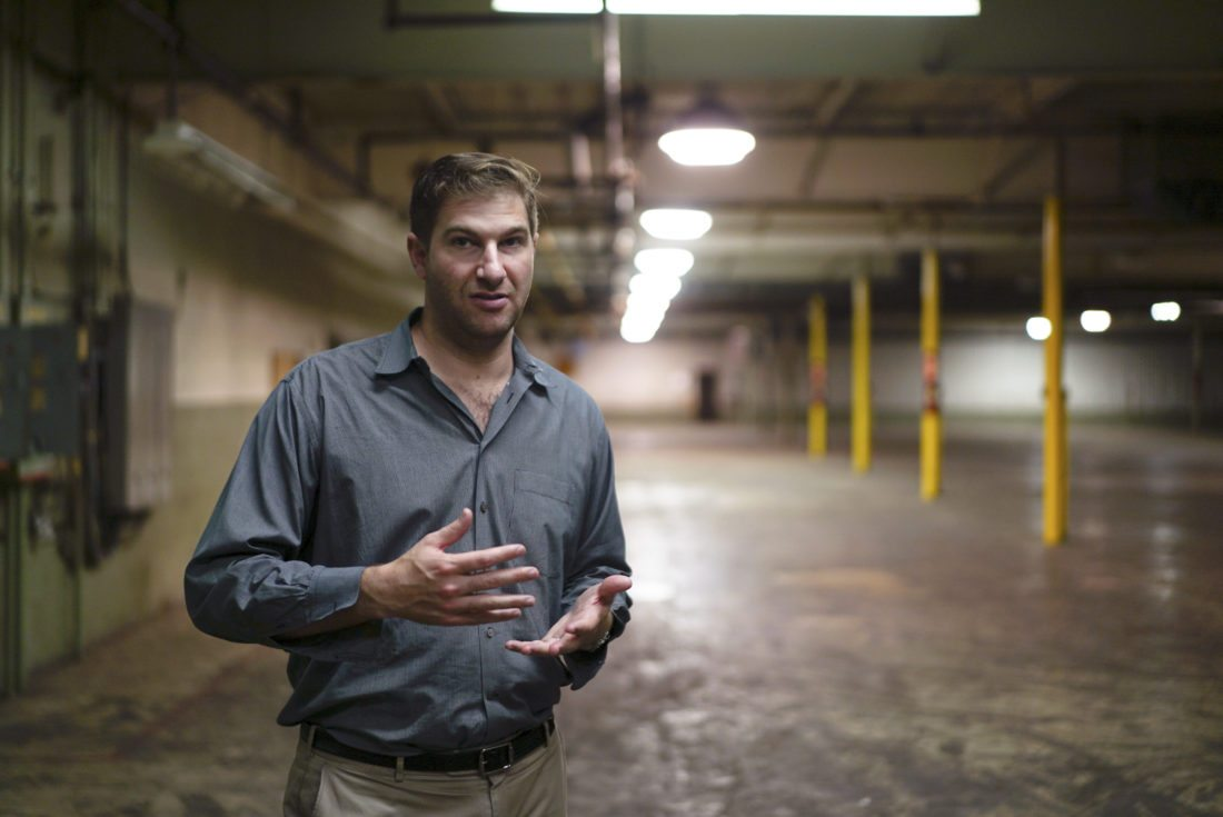 Daniel Kessler, a plastics businessman, gestures in a former toy factory in Youngstown, Ohio on Thursday, July 13, 2017. Kessler is the grandson of a toy and plastics tycoon who patented an early version of the hula-hoop. He and his uncle, Brian, applied for a license to grow medical marijuana in Ohio and plan to renovate this factory into their cultivation facility if they're selected. (AP Photo/Dake Kang)