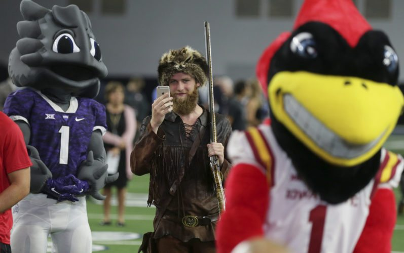 The West Virginia mascot Mountaineer uses a smart phone to take in the Big 12 NCAA college football media day in Frisco, Texas, Monday, July 17, 2017. (AP Photo/LM Otero)