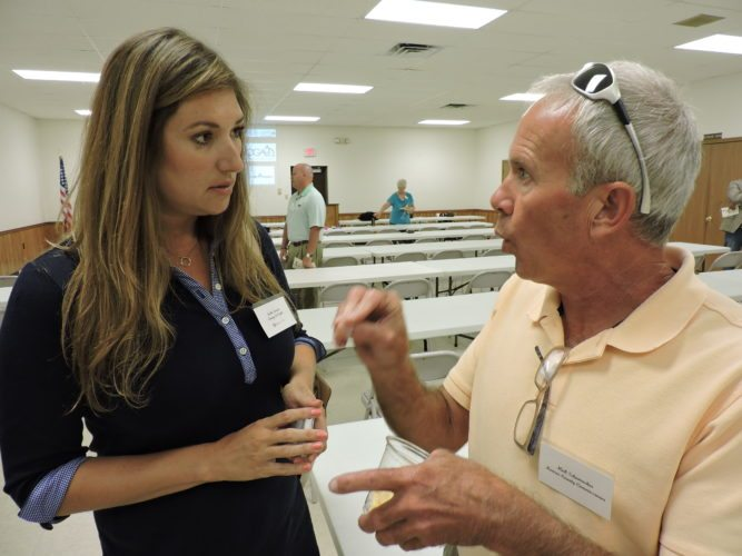 Photo by Janell Hunter Jackie Stewart of Energy In Depth Ohio speaks with Monroe County Commissioner Mick Schumacher after an oil and gas industry forum in Woodsfield Thursday.