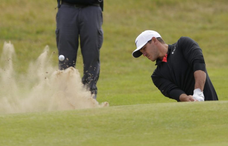 Brooks Koepka of the United States plays out of a bunker on the 18th hole during the first round of the British Open Golf Championship, at Royal Birkdale, Southport, England Thursday, July 20, 2017. (AP Photo/Alastair Grant)