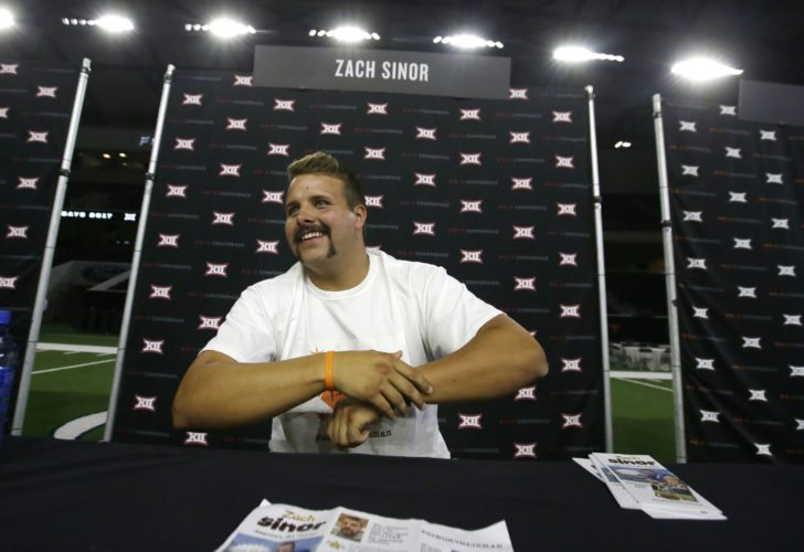 Oklahoma State punter Zach Sinor smiles while giving an interview during the Big 12 NCAA college football media day in Frisco, Texas, Tuesday, July 18, 2017. (AP Photo/LM Otero)