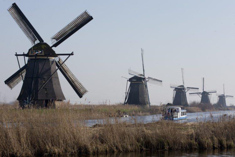 FILE - In this Feb. 14, 2017, file photo, tourists on a boat tour windmills lining Hooge Boezem van de Overwaard canal at the Unesco World Heritage site in Kinderdijk, Netherlands. (AP Photo/Peter Dejong, File)