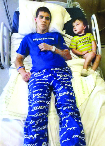 Ryan Bishop receives a pep talk from his little buddy, nephew Easton Clingenpeel, on May 25, 2016, the day that Ryan was discharged from Acuity to go          to Health South      Rehabilitation Center in Sewickley, Pa. He has completed two rounds of rehabilitation at Health South and continues to receive outpatient therapy in Wheeling.