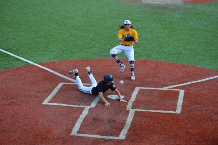 Photo by Cody Tomer. Weirton's Ty Logston slides into home, while Wheeling's Jub Delbrugge awaits the throw to the plate during Friday's Area One Tournament at Bethany.