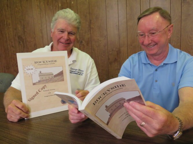 "Photo by Janice Kiaski Authors Thomas Zielinsky of Weirton, right, and George Hines III of New Cumberland check out copies of their newly released book, ""Rockyside, A Forgotten Mining Community,"" an undertaking that constituted two years of local research."