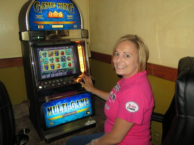 Photo by Joselyn King Patricia Williams, an employee at Undo's Sports Bar in Benwood, demonstrates a video lottery machine.