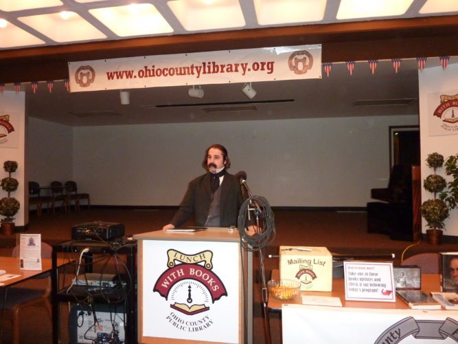 Photo by Linda Comins Literary historian Rob Velella portrays 19th-century author Nathaniel Hawthorne for a Lunch With Books program at the Ohio County Public Library Tuesday.