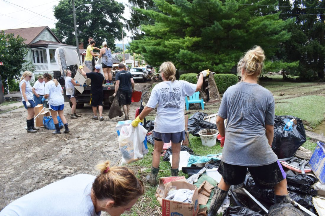 Many friends and family turned out Monday to help the DeFruscio family clean up their property between Miller and North Park streets in the Edgwood section of Wheeling.