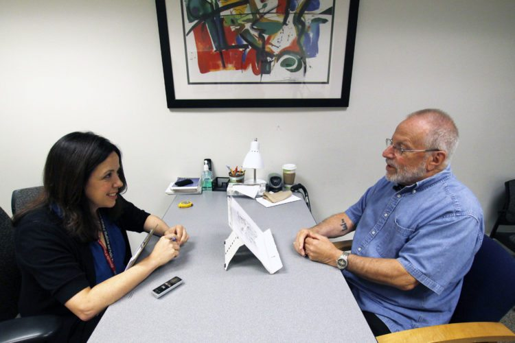 Kim Mueller, left, administers a test on July 6 to Alan Sweet, in which he describes an illustration, as part of a University of  Wisconsin-Madison study on dementia. The study found that for some people,   subtle changes in everyday speech can be correlated with early mild cognitive impairment, which can be a precursor to Alzheimer's disease.
