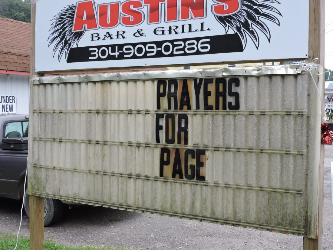 Photo by Heather Ziegler A sign outside Austin's Bar and Grill in Triadelphia seeks prayers for Page Gellner.