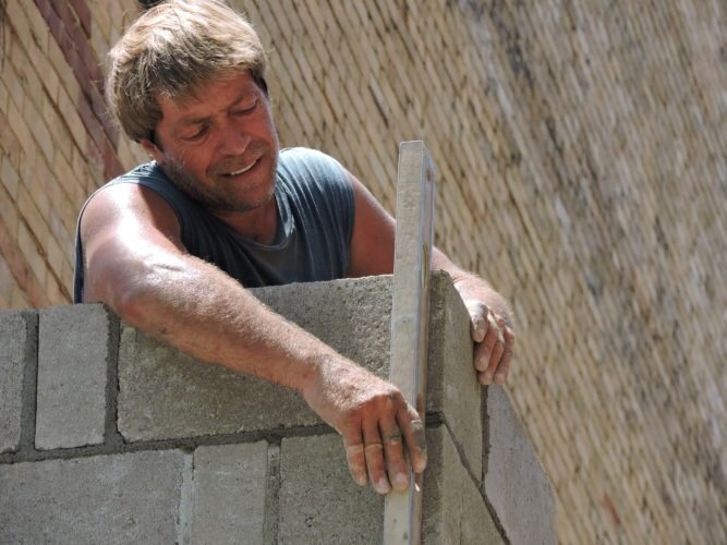 Photo by Casey Junkins Bricklayer Charles Hlebiczki works at the former Gerrero Music building in downtown Wheeling to prepare the structure for new development.