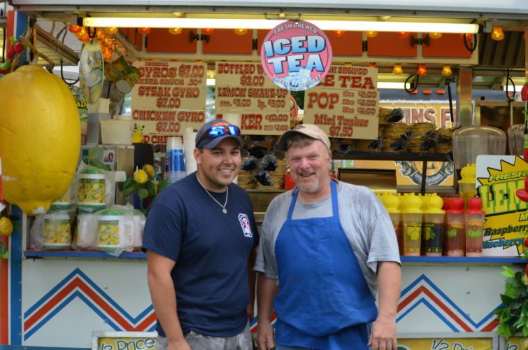 Photo by Janell Hunter Betty Zane Days Festival Chairman and Martins Ferry firefighter Cody Engleman, left, poses with longtime festival food vendor Dwight Jenewein at the festival's kickoff on Tuesday.