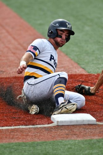 Paul Church/ The Courier-Tribune  Wheeling Post 1's Isaac Rine slides safely into third against Covington Post 32.