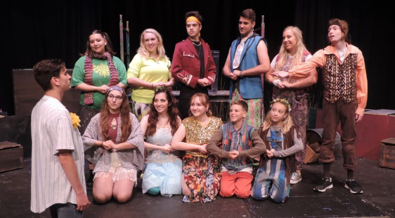 "The cast of ""Godspell"" performs ""All Good Gifts"" as they rehearse for their upcoming production. Pictured in front is Woody Pond as Jesus. Kneeling front from left are: Joana Tsuhlares, Megan Chacalos, Veda Wheeler, Ben Ashmore and Stephanie Ebarb; back, Josie Jarrett, Lexie Kosanovic, Maguire Glass, Ryan Bartsch, Betsy Brossman and David Gaudio. Performances are at 7 p.m. today and Saturday, Aug. 5, at Towngate Theatre. Tickets can be purchased at www.oionline com, by calling 304-242-7700 or at the door, if available. Towngate Theatre is located at 2118 Market St. in Centre Wheeling."