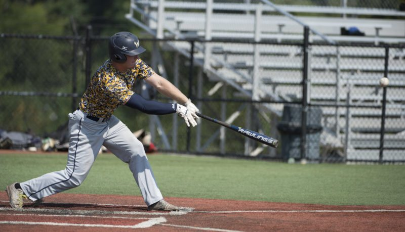 Photo by PJWard-Brown/The Courier-Tribune Wheeling's Gage Giovengo takes a swing at a pitch during the Southeast Regional Tournament in Ashboro, N.C. Post 1 ended its season in an 8-1 loss to Alabama Thursday.
