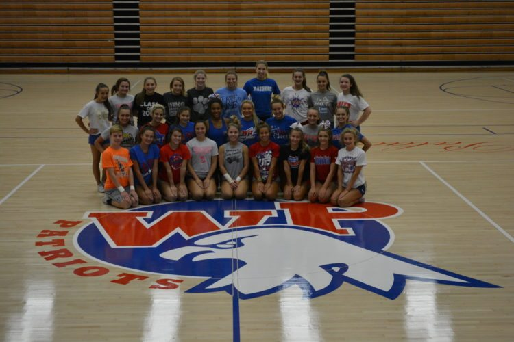 Photo by Josh Strope Wheeling Park cheerleaders take a break during practice to take a picture on the new gym floor at Wheeling Park High School.