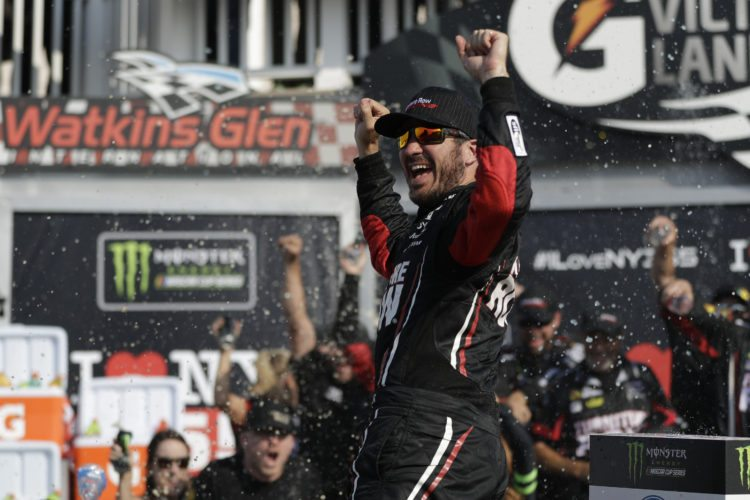 Martin Truex Jr. celebrates after winning the NASCAR Cup Series auto race, Sunday, Aug. 6, 2017, in Watkins Glen, N.Y. (AP Photo/Matt Slocum)