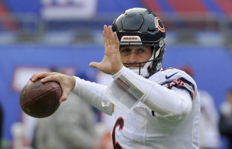 FILE - In this Nov. 20, 2016, file photo, Chicago Bears quarterback Jay Cutler (6) warms up before playing against the New York Giants in an NFL football game, in East Rutherford, N.J. A person familiar with the situation says Cutler, a free agent quarterback, has agreed to terms on a contract with the Miami Dolphins, Sunday, Aug. 6, 2017. Cutler is expected to compete with Matt Moore for the Dolphins' starting job while Ryan Tannehill remains out with a left knee injury that could sideline him for the entire season. (AP Photo/Bill Kostroun, File)