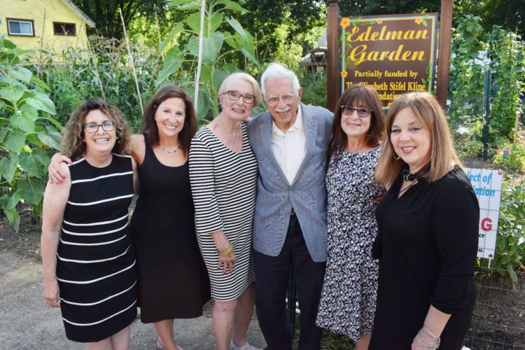Photos by Scott McCloskey Aaron and Rhoda Edelman formerly of Wheeling were honored Tuesday by The Seeing Hand Association for the donation of a lot on Wheeling Island. They are pictured in front of the garden with their daughters and Seeing Hand Executive Director Karen Haught. From left are: Marsha Harvey, Joyce Edelman, Rhoda and Aaron Edelman, Faye Greenlee, and Haught.