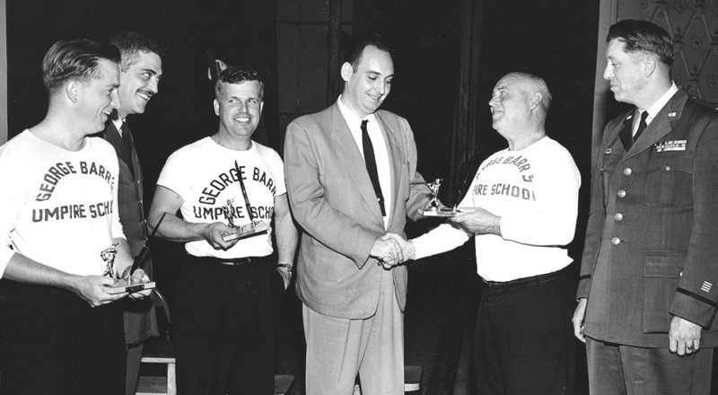 Photo provided Umpires receive awards at the 1954 FEAF Baseball Officials Clinic. From left to right: Bob Rine, Major John Hoppin, Gene Bothell, John Scially, George Barr and Colonel Walter G. W. Clatanoff.