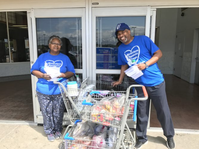 Photo Provided Janice Peyton and the Rev. Darrell Cummings are shown outside at the St. Clairsville Wal-Mart Aug. 5, collecting school supplies for the Stuff the Bus event. The school supplies will be handed out on Saturday morning at the North Wheeling Dream Center.