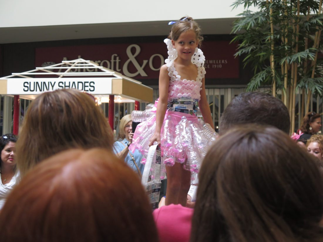 From left, Annabella Blatt, 9, Olivia Blatt, 9, both of Wheeling and Martins Ferry seventh-grader Audra Kosky model their handmade designs for the Upcycled Fashion Show at the Ohio Valley Mall in St. Clairsville on Aug. 5. Annabella and Olivia took first and second place, respectively, in their age group, while Audra won third in the 10-14 age group.